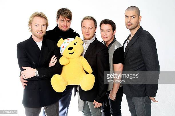 Boyzone members Ronan Keating Keith Duffy Mikey Graham Stephen Gately and Shane Lynch pose with 'Pudsey Bear' to mark the reunion of the Irish...