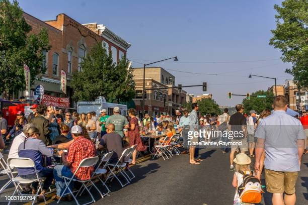bozeman montana summer street event - small town stock pictures, royalty-free photos & images