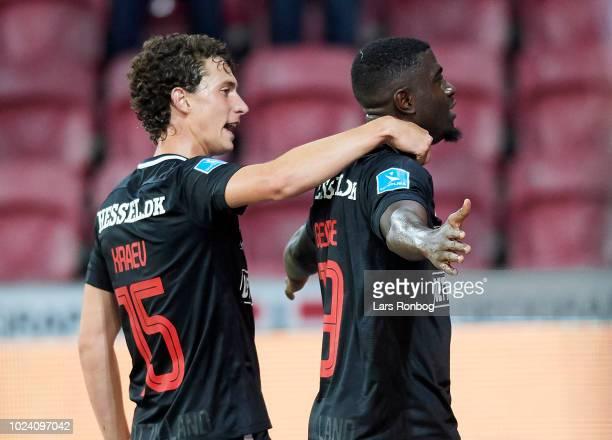 Bozhidar Kraev and Mayron George of FC Midtjylland celebrate after scoring their third goal during the Danish Superliga match between FC Midtjylland...