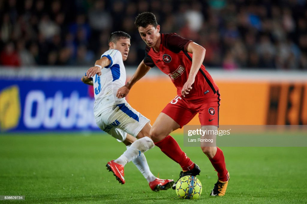 Bozhidar Kraev of FC Midtjylland and Esteban Sachetti of Apollon Limassol FC compete for the ball during the UEFA Europa League Playoff 2nd Leg match between FC Midtjylland and Apollon Limassol at MCH Arena on August 24, 2017 in Herning, Denmark.