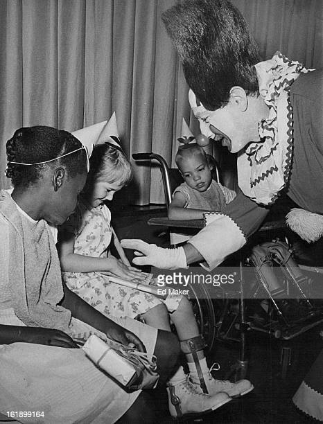 JUL 24 1964 AUG 2 1964 Bozo the clown greets birthday celebrants Debbie Dixon left Susie David and Mark Schaffer at Cerebral Palsy Center See Party...
