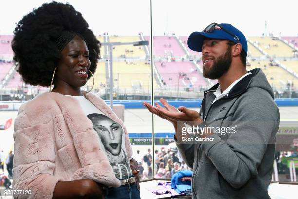 Bozoma Saint John meets with Darrell Wallace Jr driver of the Farmer John Chevrolet prior to the start of the Monster Energy NASCAR Cup Series Auto...