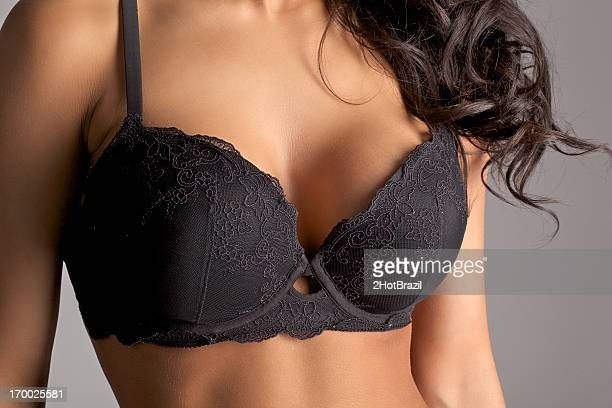 bra and breasts close-up - implant stock photos and pictures