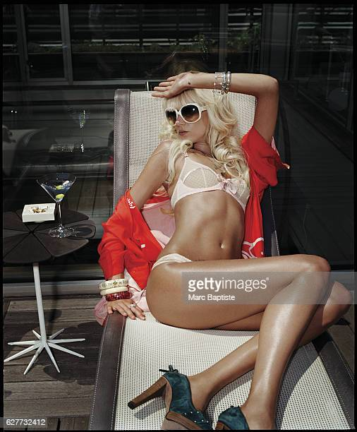 Bra and panties by Agent Provocateur Vintage robe stylist's own Shoes by Le Flesh for Manuela Morin Heart necklaces by Bing Bang Sunglasses by dior...