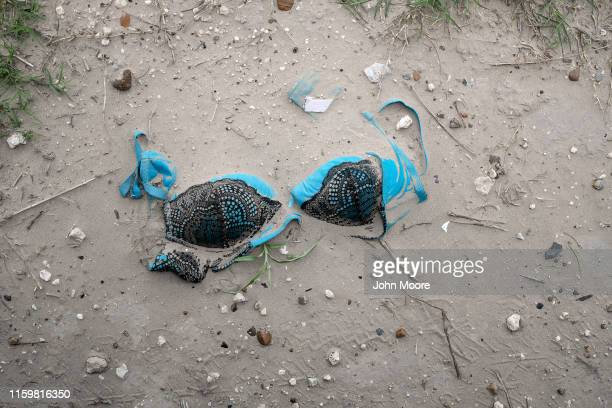 A bra lies in the dirt along an immigrant trail near the USMexico border on July 02 2019 in McAllen Texas Immigrants mostly from Central America...