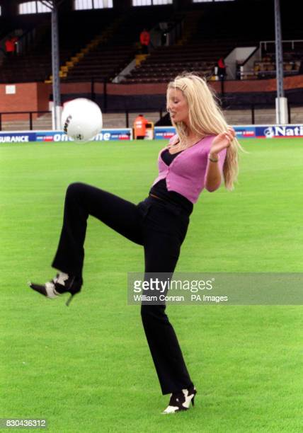 Bra model Emma B showing off her ball skills before the inaugral Women's Charity Shield football match between Arsenal and Croydon in support of...