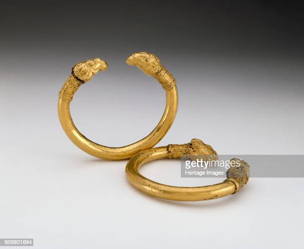 Bracelet 5th century BC Pair of bracelets bronze core but are encased in gold terminals are in the form of ram's heads each made in two pieces joined...