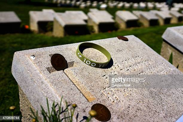 A bracelet and Australian coins lying on a grave stone where mostly Australian soldiers who died during the Gallipoli Campaign at Shrapnel Valley...
