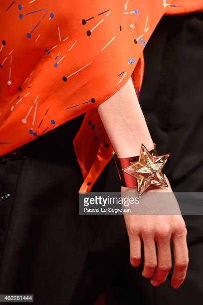 A bracelet detail is seen as a model walks the runway during the Schiaparelli show as part of Paris Fashion Week Haute Couture Spring/Summer 2015 on...