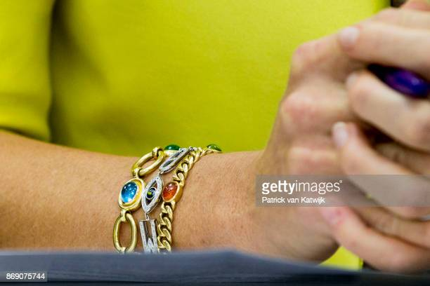 Bracelet of Queen Maxima of The Netherlands during her visit to the local UN office local and national banks on November 1 2017 in Abuja Nigeria
