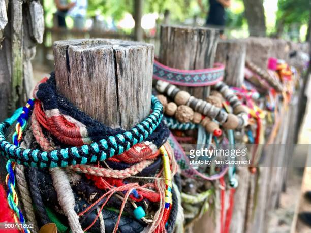 bracelets left by visitors at choeung ek killing fields, cambodia - khmer genocide stock pictures, royalty-free photos & images