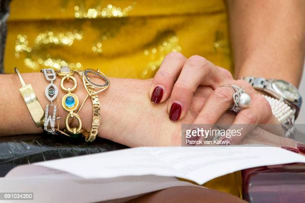 Bracelets of Queen Maxima of The Netherlands visits Minister Dao Ngoc Dung of labor less valid and social affairs on June 1 2017 in Hanoi Vietnam