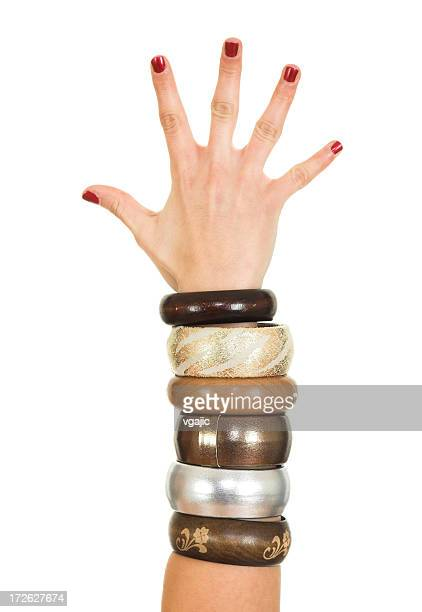 bracelet's on hand - bracelet stock pictures, royalty-free photos & images