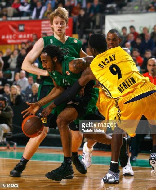 Bracey Wright #6 of DKV Joventut competes with Ansu Sesay #9 of Alba Berlin during the Euroleague Basketball Game 9 match between DKV Joventut and...