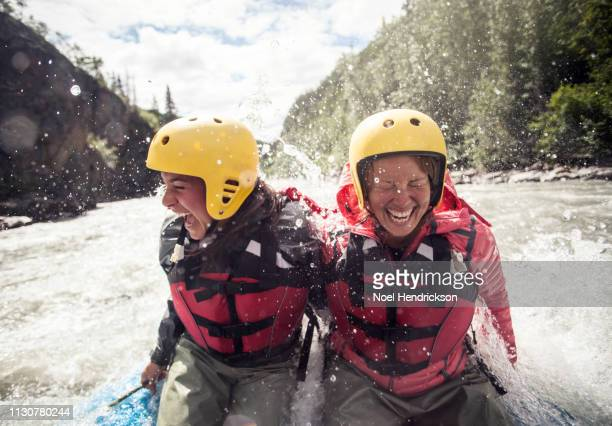 bracing for impact - whitewater rafting stock pictures, royalty-free photos & images