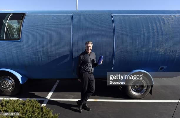 Bracken Darrell president and chief executive officer of Logitech International SA stands for a photograph in front of van designed to resemble a UE...