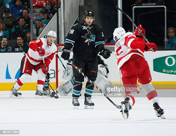 Bracken Kearns of the San Jose Sharks blocks a shot against Danny DeKeyser of the Detroit Red Wings during an NHL game on January 9 2014 at SAP...