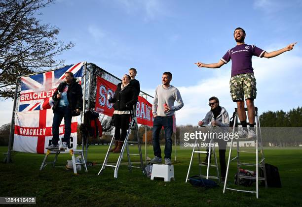 Brackley Town fans use step ladders to watch from outside the stadium during the FA Cup First Round match between Brackley Town and Bishop's...