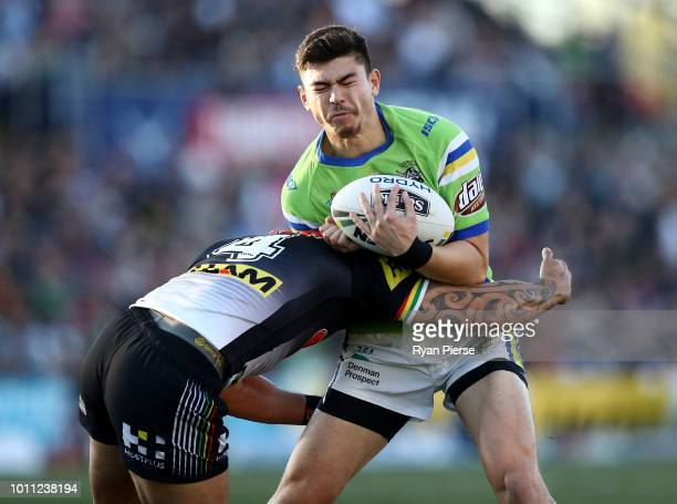 Brad Abbey of the Raiders is tackled by Dean Whare of the Panthers during the round 21 NRL match between the Penrith Panthers and the Canberra...