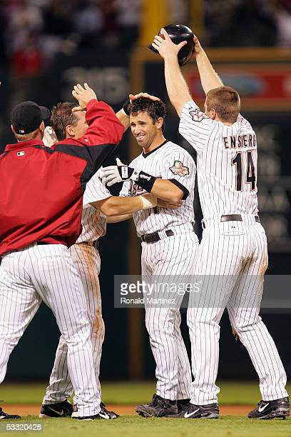 Brad Ausmus of the Houston Astros celebrates with teammates after hitting an RBI double to win the game against the New York Mets in the 9th inning...