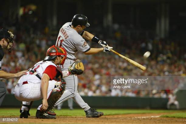 Brad Ausmus of the Houston Astros hits the ball as Jason LaRue of the Cincinnati Reds watches during the game on May 21, 2004 at Great American...