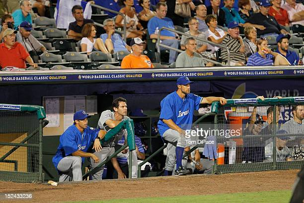 Brad Ausmus Shawn Green and Gabe Kapler of Team Israel look on from the dugout during game one of the Qualifying Round of the World Baseball Classic...
