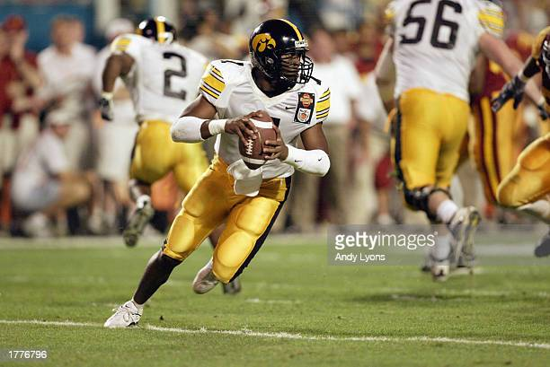 Brad Banks of Iowa rolls out against USC during the FedEx Orange Bowl at Pro Player Stadium on January 2, 2003 in Miami, Florida. USC defeated Iowa...