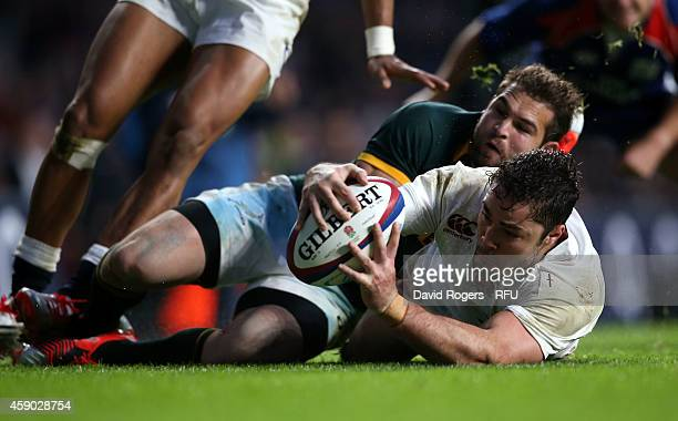 Brad Barrit of England dives over to score a try during the QBE Intenational match between England and South Africa at Twickenham Stadium on November...
