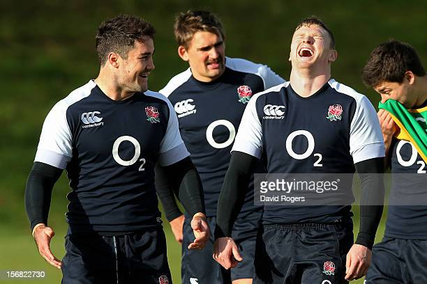 Brad Barritt and Chris Ashton share a joke during the England training session at Pennyhill Park on November 22 2012 in Bagshot England