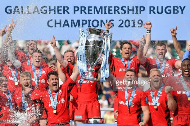 Brad Barritt and Owen Farrell of Saracens lift the trophy after winning the the Gallagher Premiership Rugby Final between Exeter Chiefs and Saracens...