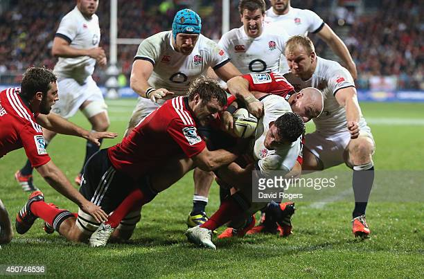 Brad Barritt of England dives over for a try during the match between the Crusaders and England at the AMI Stadium on June 17 2014 in Christchurch...