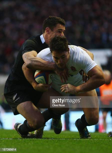 Brad Barritt of England goes over to score the first try during the QBE International match between England and New Zealand at Twickenham Stadium on...