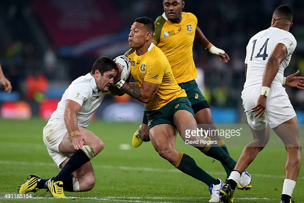 Brad Barritt of England tackles Israel Folau of Australia during the 2015 Rugby World Cup Pool A match between England and Australia at Twickenham...