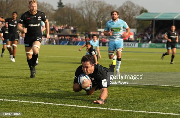 Brad Barritt of Saracens dives over for their third try during the Champions Cup Quarter Final match between Saracens and Glasgow Warriors at Allianz...