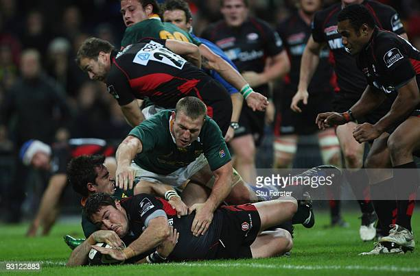 Brad Barritt of Saracens dives over to score during the friendly match between Saracens and South Africa at Wembley Stadium on November 17, 2009 in...