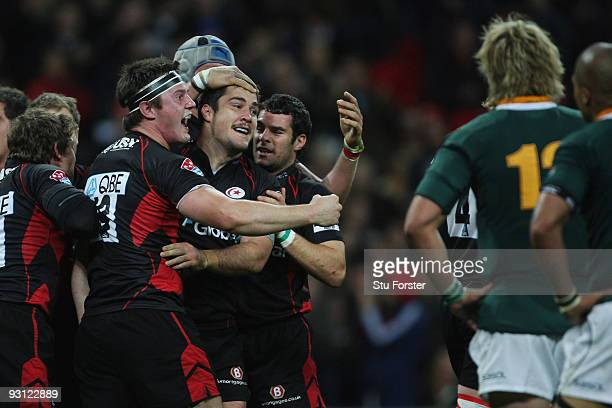 Brad Barritt of Saracens is congratulated by team mates after scoring a try during the friendly match between Saracens and South Africa at Wembley...