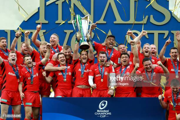 Brad Barritt of Saracens lifts the Champions Cup Trophy following the Champions Cup Final match between Saracens and Leinster at St. James Park on...