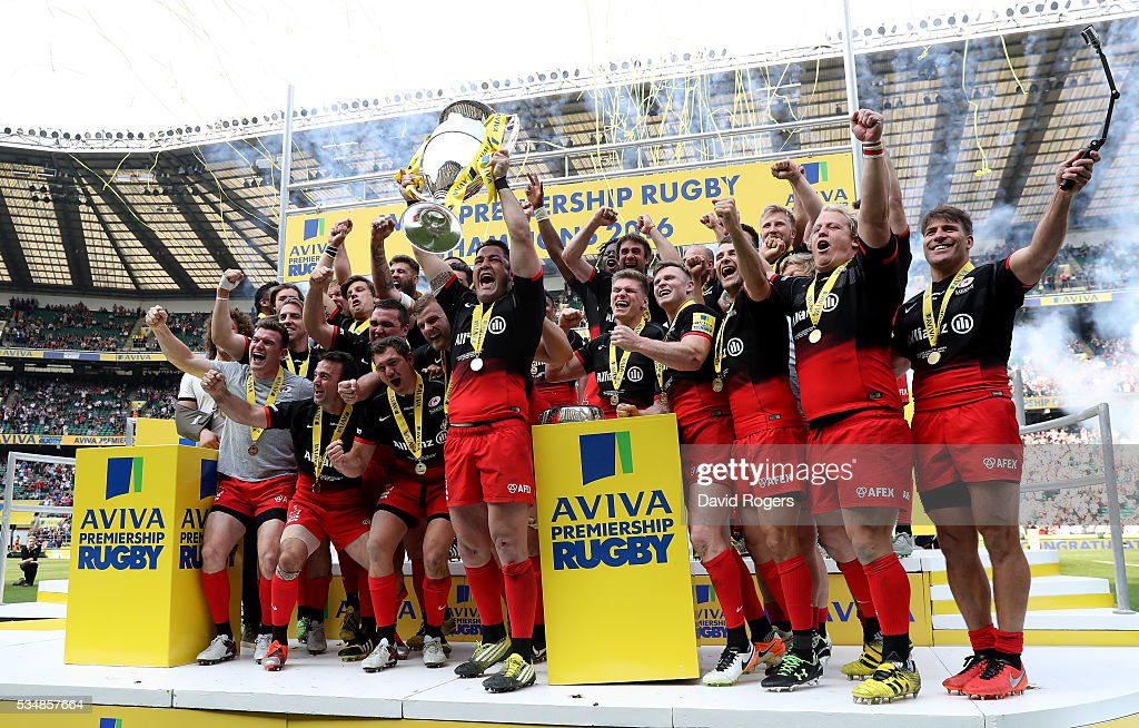 Brad Barritt of Saracens lifts the trophy after the Aviva Premiership final match between Saracens and Exeter Chiefs at Twickenham Stadium on May 28, 2016 in London, England.