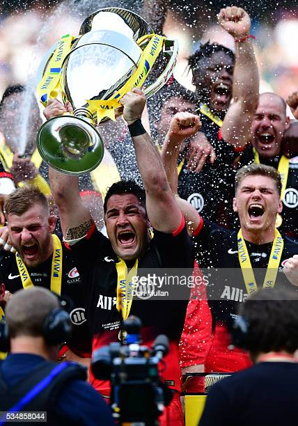 Brad Barritt of Saracens lifts the trophy after voctory in the Aviva Premiership final match between Saracens and Exeter Chiefs at Twickenham Stadium...