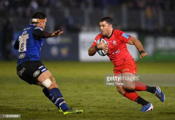 Brad Barritt of Saracens looks to break past the tackle from Francois Louw of Bath Rugby during the Gallagher Premiership Rugby match between Bath...