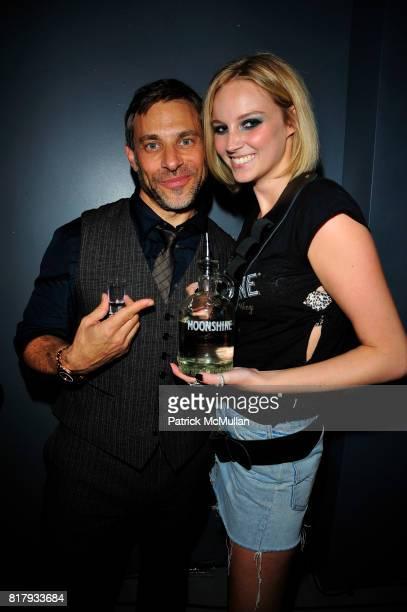 Brad Beckerman and Moonshine Shot Girl attend JOHN VARVATOS AND STILLHOUSE CELEBRATE A DECADE OF JOHN VARVATOS AND THE LAUNCH OF ORIGINAL MOONSHINE...