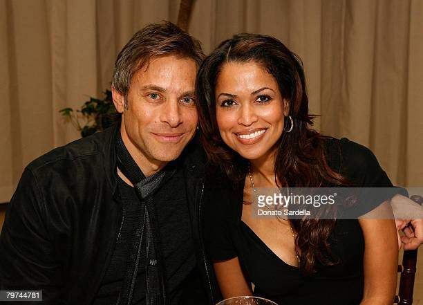 LOS ANGELES CA FEBRUARY 11 Brad Beckerman and Tracey Edmonds attend the John Varvatos launches is first fragrance for women at a private dinner on...