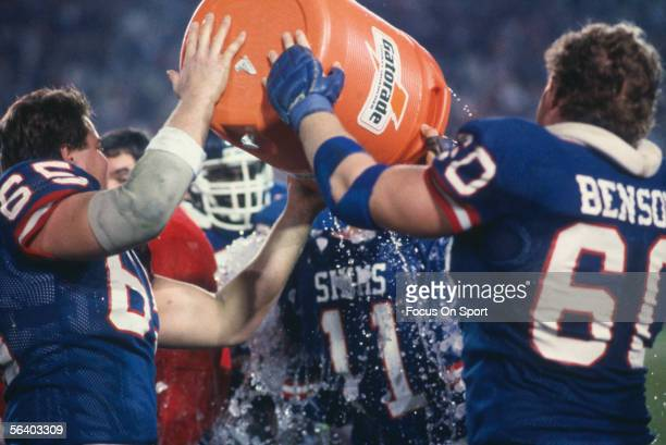 Brad Benson Offensive Lineman for the New York Giants dumps a bucket of water over the head of Phil Simms during Super Bowl XXI against the Denver...