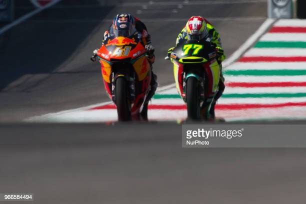 Brad Binder of Red Bull KTM Ajo and Dominique Aegerter of Kiefer Racing battle during the warmup of the Oakley Grand Prix of Italy at International...