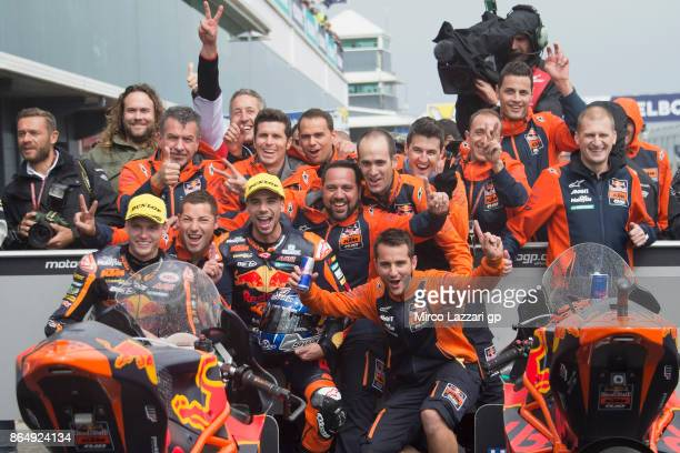 Brad Binder of South Africa and Red Bull KTM Ajo and Miguel Oliveira of Portugal and Red Bull KTM Ajo celebrates under the podium at the end of the...
