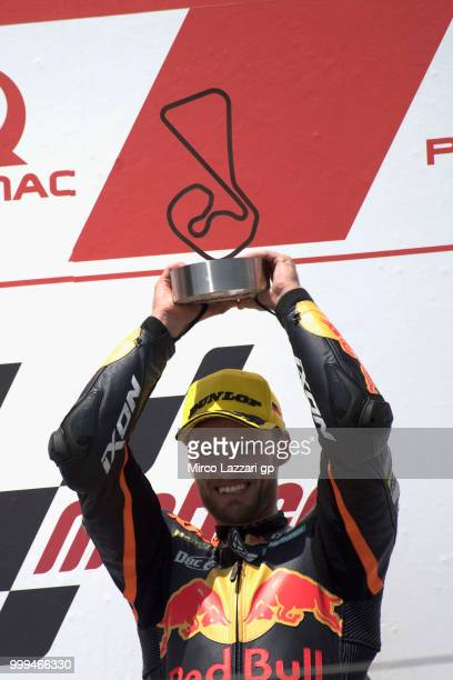 Brad Binder of South Africa and Red Bull KTM Ajo celebrates the victory on the podium at the end of the moto2 race during the MotoGp of Germany -...