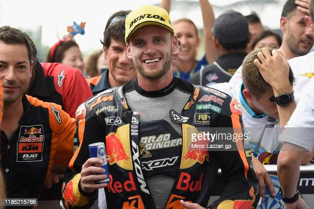Brad Binder of South Africa and Red Bull KTM Ajo celebrates the victory under the podium during the Moto2 race during the MotoGP of Malaysia - Race...