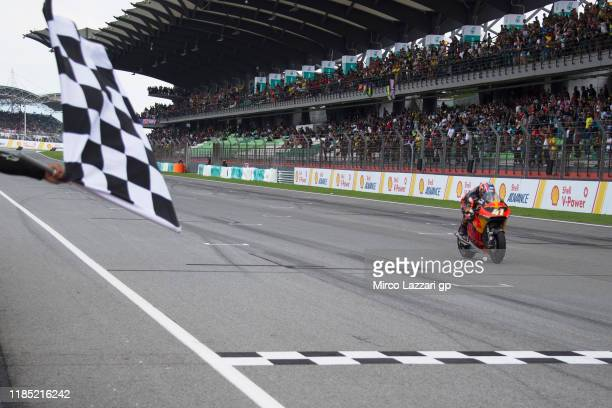 Brad Binder of South Africa and Red Bull KTM Ajo cuts the finish lane and celebrates the victory during the Moto2 race during the MotoGP of Malaysia...