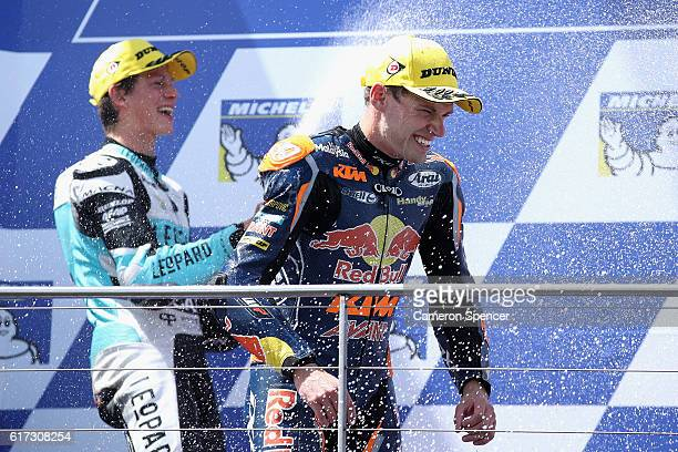 Brad Binder of South Africa and Red Bull KTM Ajo is sprayed with champagne by Andrea Locatelli of Italy and Leopard Racing following the Moto3 race...