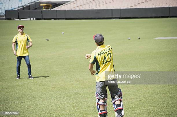 Brad Binder of South Africa and Red Bull KTM Ajo Jack Miller of Australia and Marc VDS Racing Team play during the preevent in Melbourne Cricket...